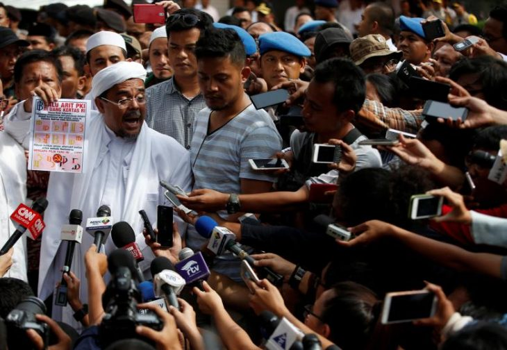 Indonesia names Islamist leader a suspect for insulting state ideology