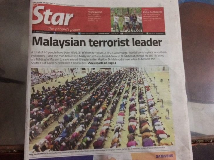 Daily says sorry over 'terrorist' headline and Muslim prayer image – See more at: http://www.themalaymailonline.com/malaysia/article/daily-says-sorry-over-terrorist-headline-and-muslim-prayer-image#sthash.OVGfPwA6.dpuf