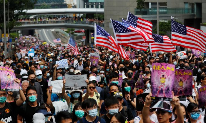Hong Kong protesters praise Trump, Congress for law; Beijing calls move sinister