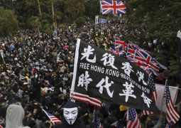 Two plain-clothes police officers beaten up, tear gas fired and rally organiser arrested in Central Hong Kong